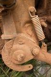 Ciérrese para arriba para arriba de elemento del motor fangoso con el resorte de tensión en una motocicleta ligera en Asia Imagen de archivo