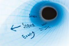 A ciência da inscrição 'em um caderno curvado é esquadrada, abstração fotografia de stock royalty free