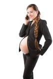 Ciężarny bizneswoman z telefon komórkowy zdjęcia stock