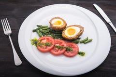 Ciężki gotowany jajko z pomidorem Obrazy Stock