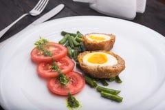 Ciężki gotowany jajko z pomidorem Zdjęcie Royalty Free