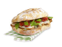 Ciabatta三明治与裁减路线的鸡蕃茄 库存图片