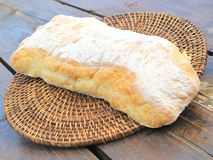 Loaf of Ciabatta Bread on Wicker and Wood Stock Image