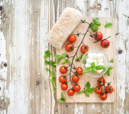 Ciabatta bread with banch of cherry-tomatoes Stock Photo