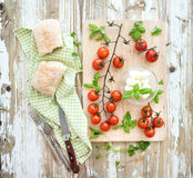 Ciabatta bread with banch of cherry-tomatoes Stock Images