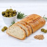 Ciabatta bread with olives food square on wooden board Royalty Free Stock Photo