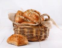 Ciabatta bread over white background. Ciabatta bread in a woven basket on a white wooden background stock photos