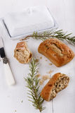 Ciabatta bread on white wooden background. Ciabatta bread with rosemary and butter dish on a white wooden background royalty free stock photo