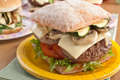 Ciabatta Burger with Beef, Mushrooms and Cheese Royalty Free Stock Image