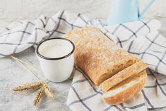 Ciabatta and cup of milk with ears Royalty Free Stock Photos