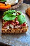 Ciabatta della mozzarella, di prosciutto di Parma e del fico Fotografie Stock
