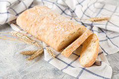 Ciabatta with ears on the table Royalty Free Stock Photo