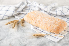 Ciabatta with ears on the table Stock Photography