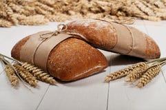 Ciabatta with ears of wheat Royalty Free Stock Photos