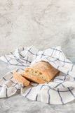 Ciabatta in a light towel Royalty Free Stock Image