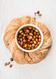 Ciabatta olive bread wreath on white wooden Royalty Free Stock Images