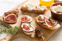 Free Ciabatta Or Bruschetta With Cottage Cheese, Figs And Honey. Sandwich With Figs And Goat Cheese Stock Image - 165635021