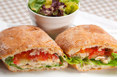 Ciabatta panini sandwich with chicken and tomato Royalty Free Stock Photography