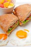 Ciabatta panini sandwich eggs tomato lettuce Stock Image