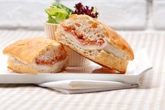 Ciabatta panini sandwich with parma ham and tomato Stock Images