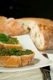 Ciabatta with pesto. Organic ciabatta bread with pesto dressing royalty free stock photography