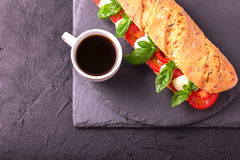 Ciabatta sandwich with caprese salad with coffee. Stock Photos