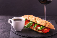 Ciabatta sandwich with caprese salad with wine and coffee. Royalty Free Stock Photography