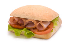 Ciabatta Sandwich with Ham, Tomato and Lettuce. Isolated on white Stock Images