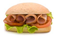 Ciabatta Sandwich with Ham, Tomato and Lettuce. On white Stock Photo