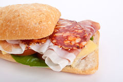 Ciabatta sandwich stuffed with sliced delicacies Royalty Free Stock Photo