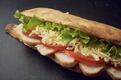 Ciabatta sandwiche with pickles, cheese, tomatoes, ham and lettuce royalty free stock images