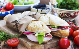 Ciabatta Sandwiches with Mortadella Ham, Lettuce and Radish Slic Royalty Free Stock Image