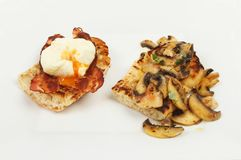 Ciabatta savory toast. Poached egg and pancetta with fried mushrooms on toasted ciabatta bread Royalty Free Stock Image