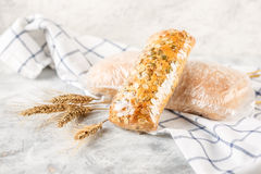 Ciabatta and small baguette with ears Royalty Free Stock Photography
