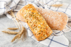 Ciabatta and small baguette with ears Royalty Free Stock Photo
