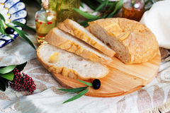 Ciabatta in still life on blackboard with olives Royalty Free Stock Image