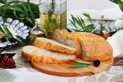 Ciabatta in still life on blackboard with olives Stock Images