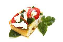 Ciabatta with tomato and cheese. Stock Photos