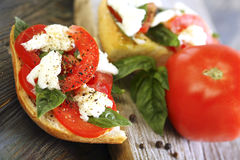 Ciabatta with tomatoes, cheese and basil close-up. Royalty Free Stock Photography