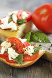 Ciabatta with tomatoes, cheese and basil. Royalty Free Stock Photo