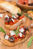Ciabatta with tomatoes, olives, parmesan cheese Royalty Free Stock Photography