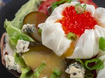 Ciabatta tomatoes salad cucumbers boiled eggs with caviar and cheese stock photo