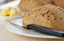 Ciabattta Roll, Knife, Plate and Butter. Stock Image