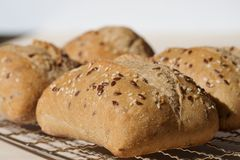 Ciabattta Rolls Topped with Linseed and Sesame Seeds. Stock Photo