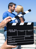 Ciak for Love Scene. Portrait of a couple in love behind a Ciak scene Stock Image
