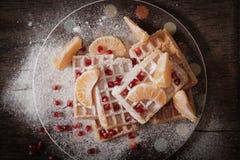 Cialde belghe quadrate con un melograno del mandarino Immagini Stock