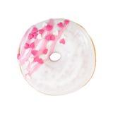 Ciambella della fragola con glassare bianco, le bande rosa e il decorativ fotografia stock libera da diritti