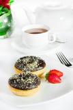 ciambella e tè del cioccolato Immagini Stock