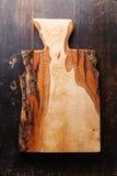 Ciapanie deska na drewnianym tekstury tle Fotografia Royalty Free