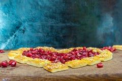 Ciastka i garnet jeleń na cutboard zdjęcie royalty free